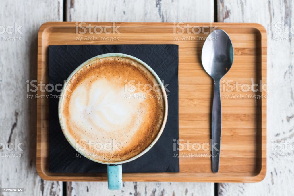 Cup of coffee cappuccino latte art trendy cafe stock photo