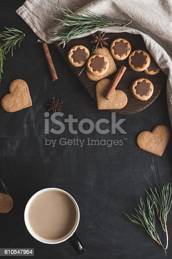 istock Cup of coffee, christmas gingerbread, pine branch, cinnamon sticks 610547954