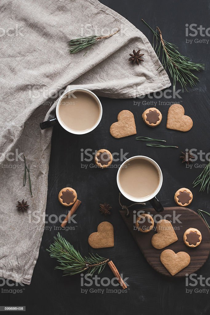 Cup of coffee, christmas gingerbread, pine branch. Flat lay stock photo