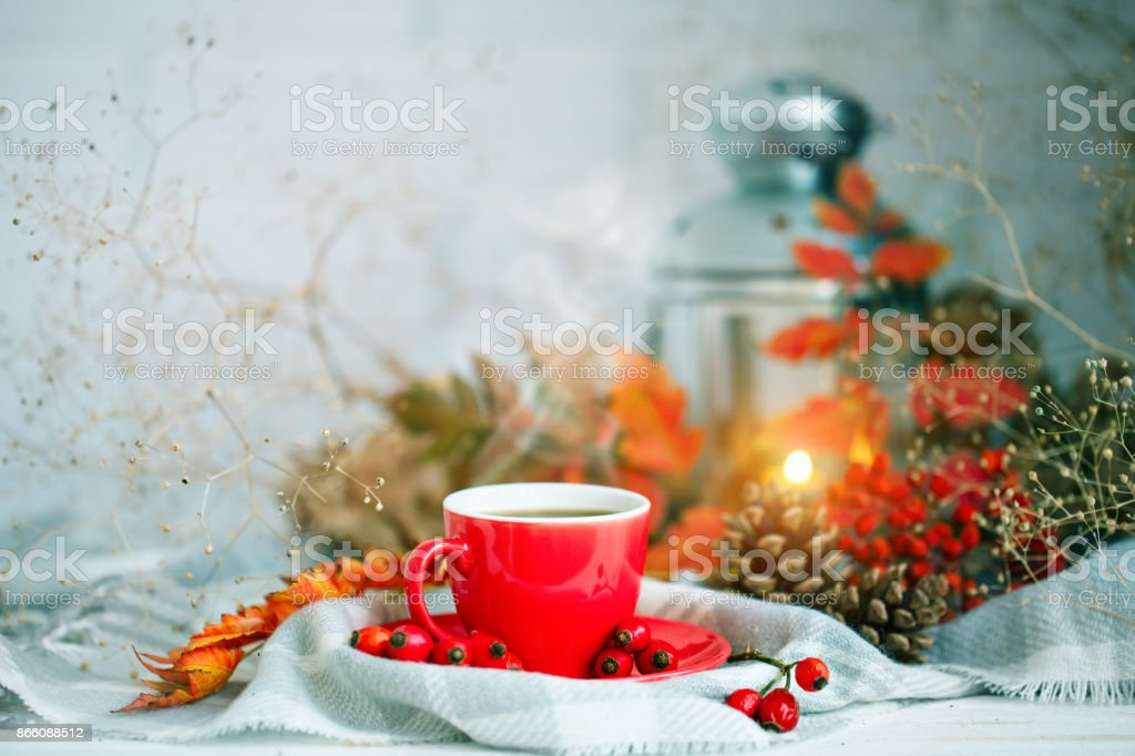Cup of coffee, cones and autumn leaves on a wooden table. Autumn background stock photo