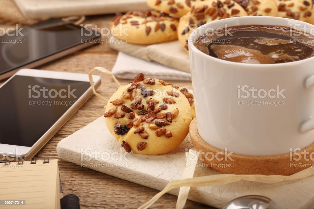 Cup of coffee cup with crunchy cookie stock photo