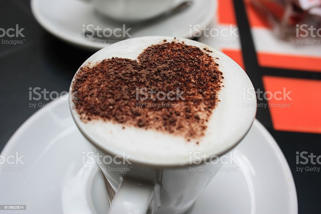 Cup of coffee decorated with heart. stock photo