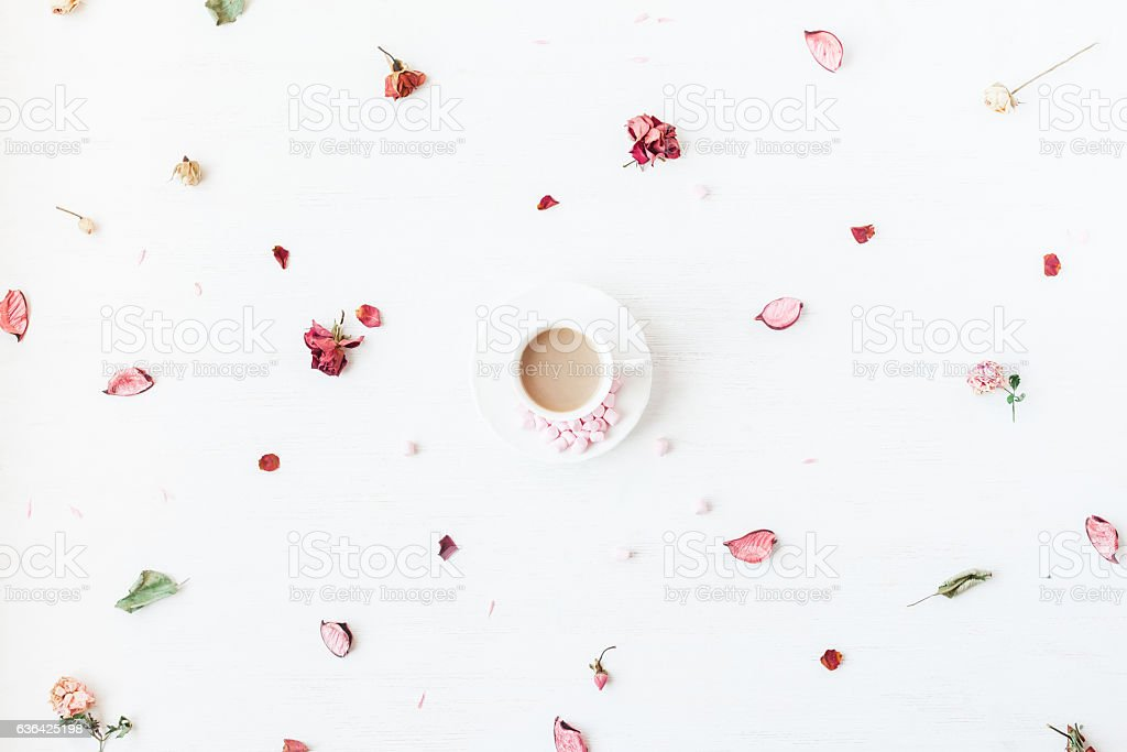 Cup of coffee, dried flowers and leaves. Flat lay stock photo