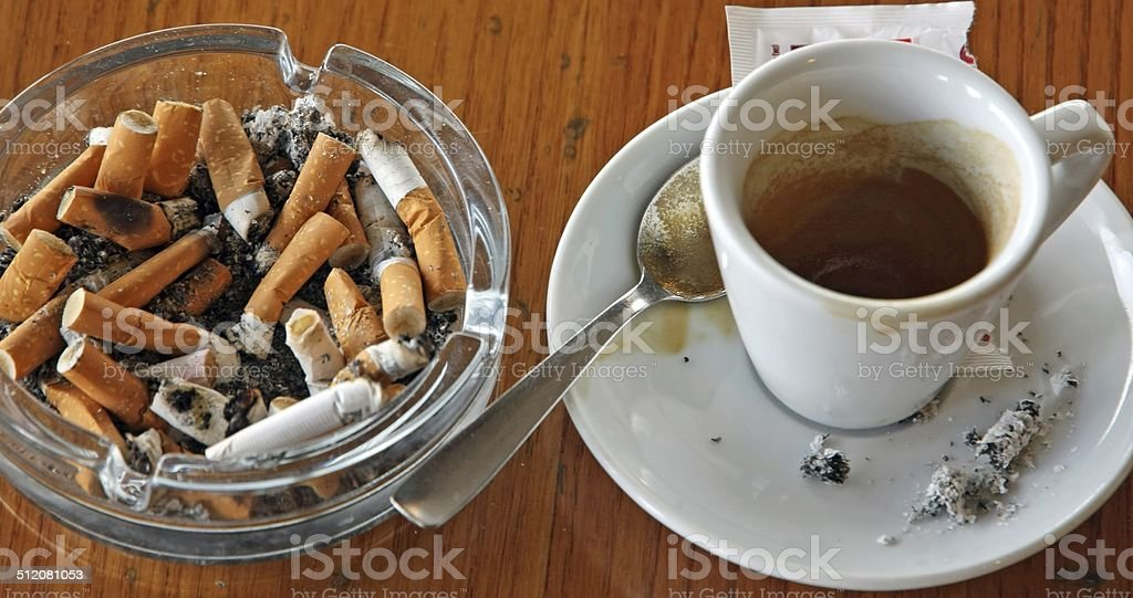 cup of coffee espresso and ashtray chock stock photo