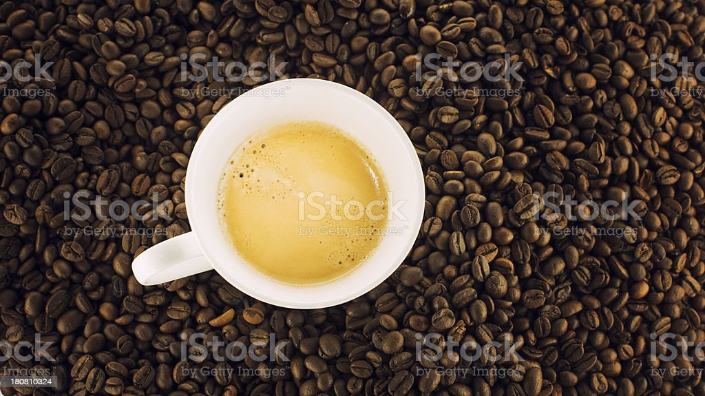 Cup of coffee espresso beans royalty-free stock photo
