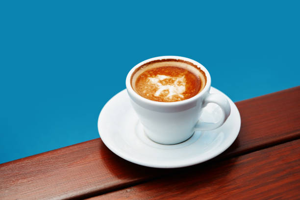 Cup of coffee espresso on a wooden table stock photo