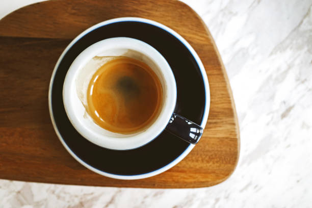Cup of coffee espresso with foam on top stock photo