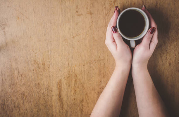cup of coffee for breakfast in his hands. selective focus. - love word foto e immagini stock