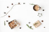 Cup of coffee, gift, larch branches, cinnamon sticks, christmas cookies