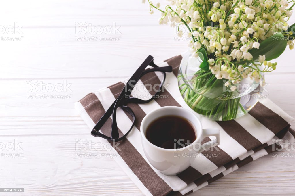 Cup of coffee, glasses and snowdrops flowers royalty-free stock photo