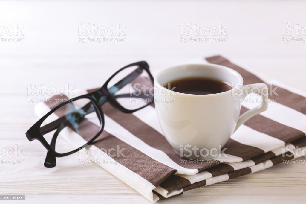 Cup of coffee, glasses  on white wooden table royalty-free stock photo