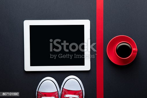 istock cup of coffee, gumshoes, ribbon and tablet 807101592