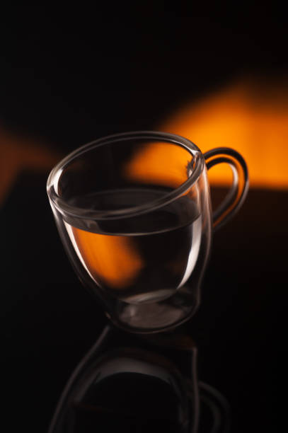 A cup of coffee in transparent glass shot in studio stock photo