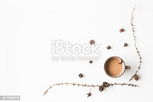 Christmas composition. Cup of coffee, larch branches, cinnamon sticks, anise star. Christmas background. Flat lay, top view