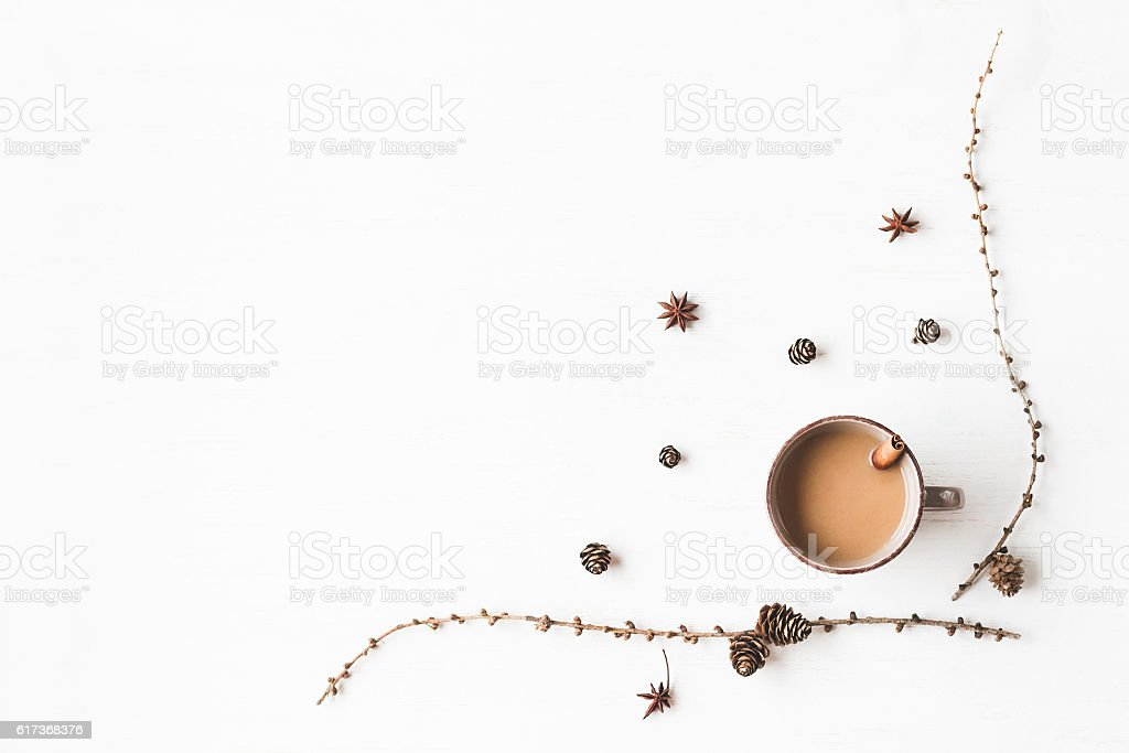 Cup of coffee, larch branches, cinnamon sticks, anise star stock photo