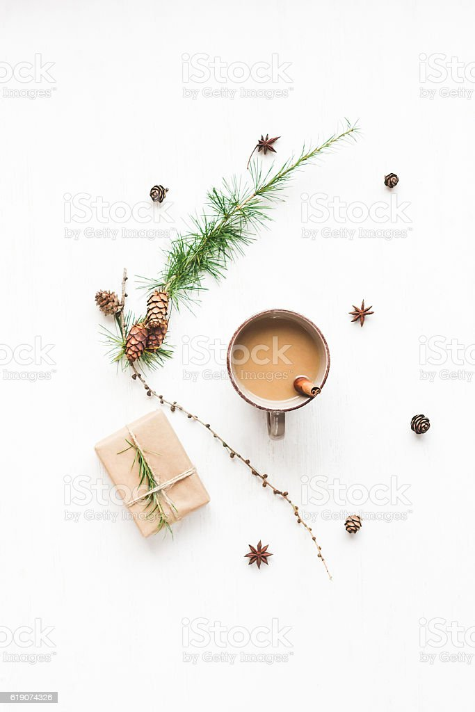 Cup of coffee, larch branches, cinnamon sticks, christmas gift stock photo