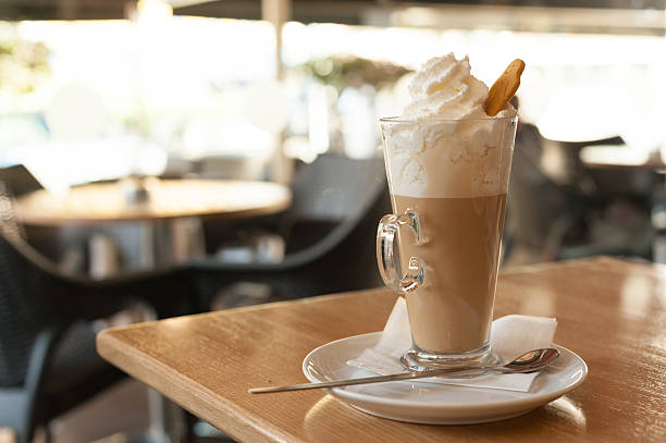cup of coffee latte with whipped cream and gingerbread - kuchentratsch stock-fotos und bilder