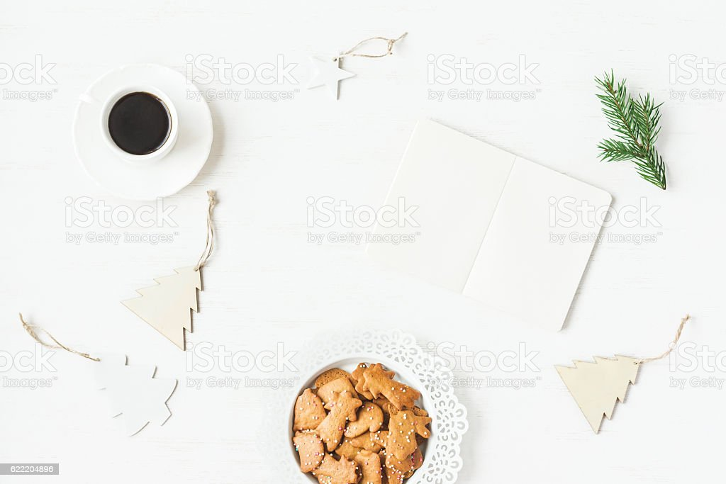 Cup of coffee, notebook, fir branch, christmas cookies. Flat lay stock photo