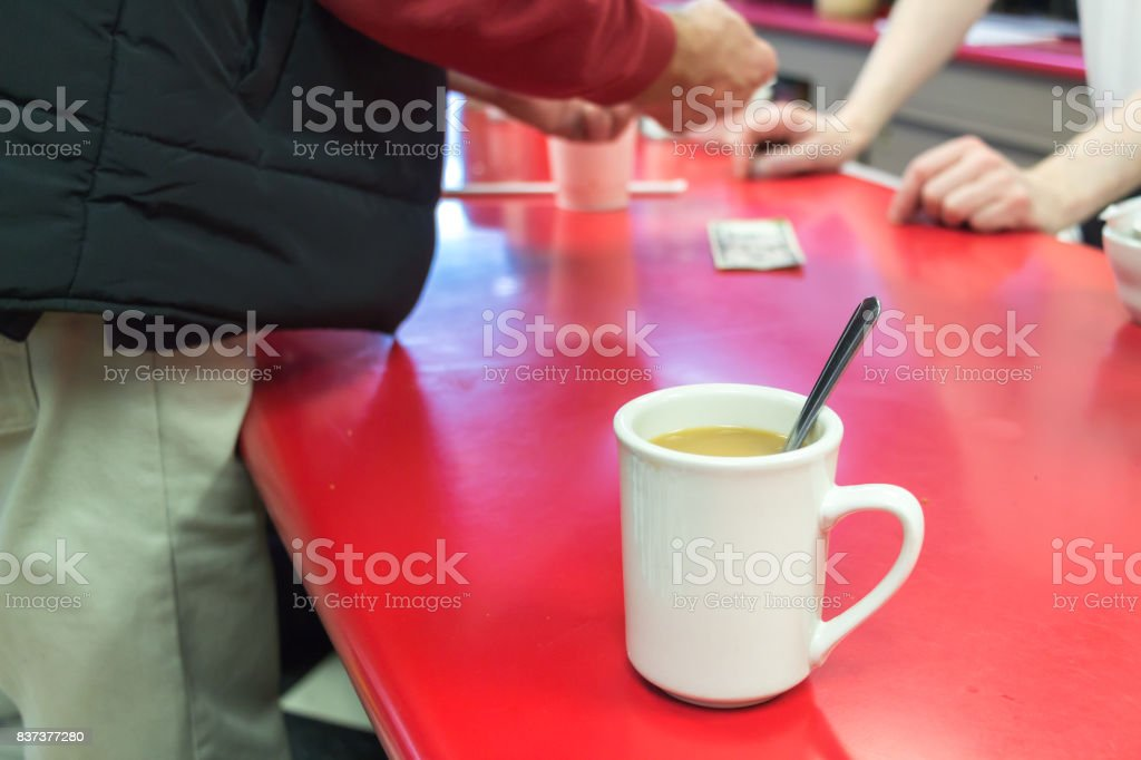 Cup of coffee on a bar table. stock photo