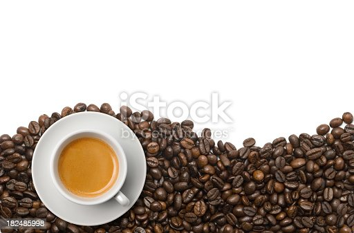 Cup of espresso coffee on coffee beans isolated on white. Find more in Zocha's coffees