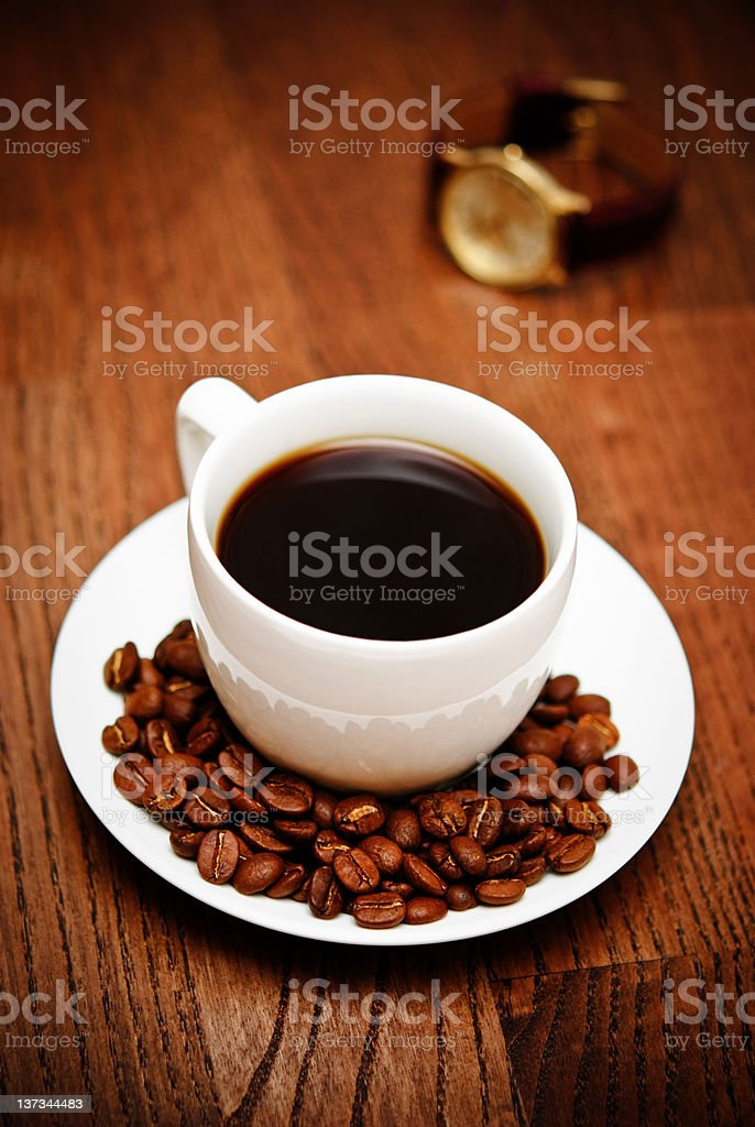 cup of coffee on a wooden table royalty-free stock photo