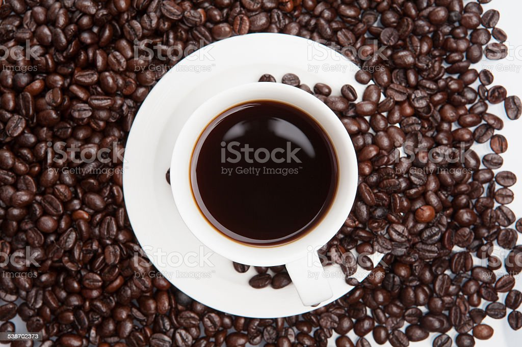 Cup of coffee on beans. stock photo