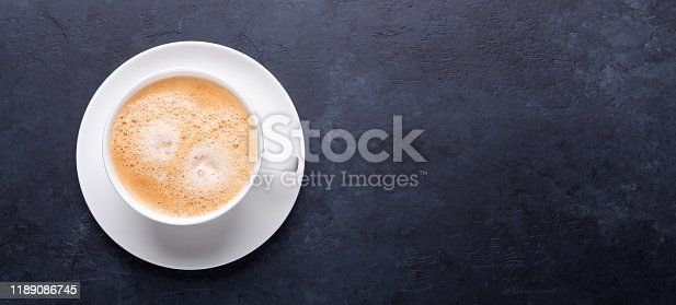 1009835562 istock photo Cup of coffee on black stone background Horizontal banner 1189086745