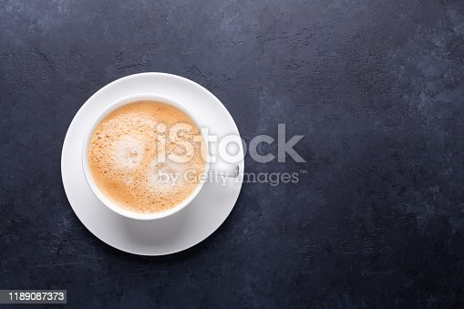 1009835562 istock photo Cup of coffee on black stone background Horizontal banner 1189087373
