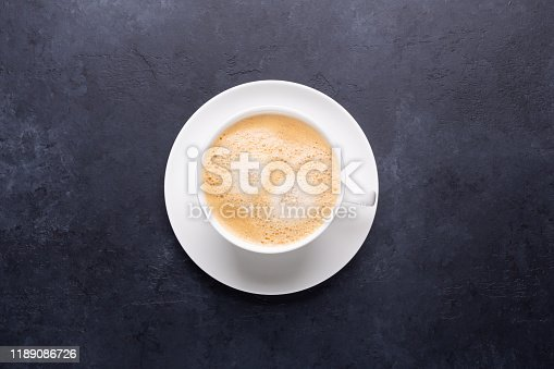 1009835562 istock photo Cup of coffee on black stone background 1189086726