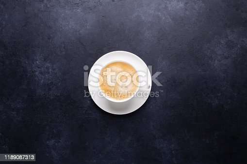 1009835562 istock photo Cup of coffee on black stone background 1189087313