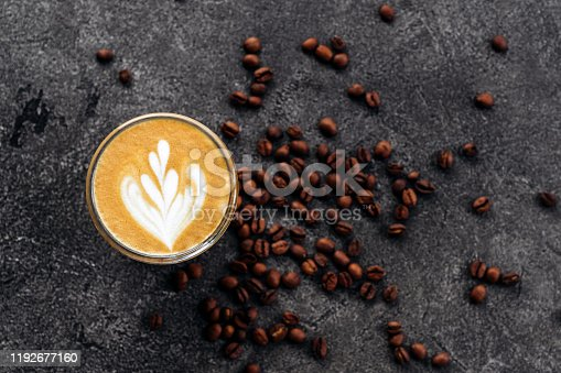 1009835562 istock photo Cup of coffee on black stone background 1192677160