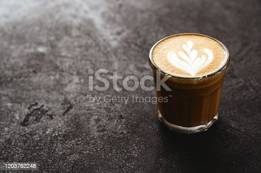 1009835562 istock photo Cup of coffee on black stone background 1203762248