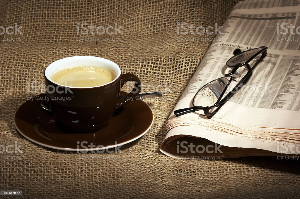 cup of coffee on burlap royalty-free stock photo