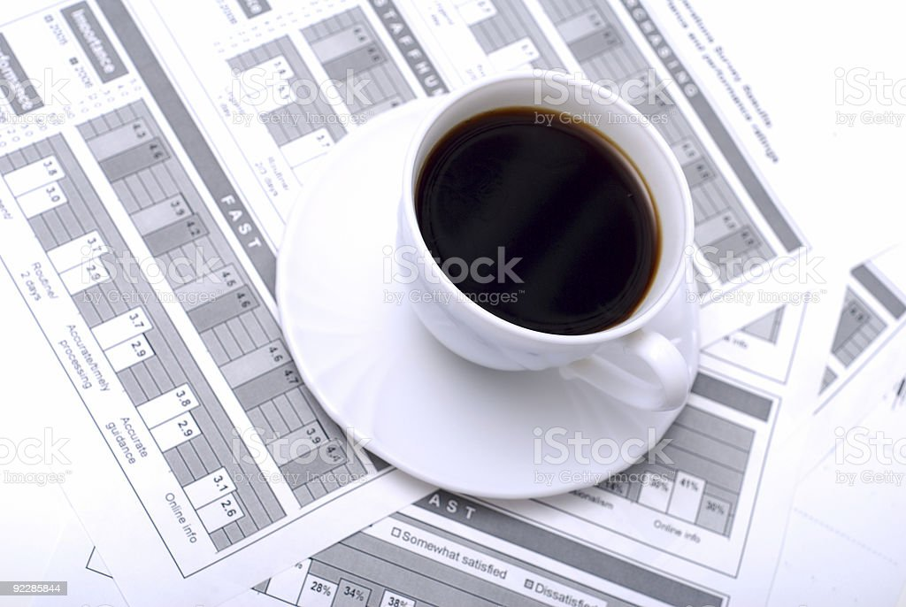 Cup of coffee on business charts royalty-free stock photo