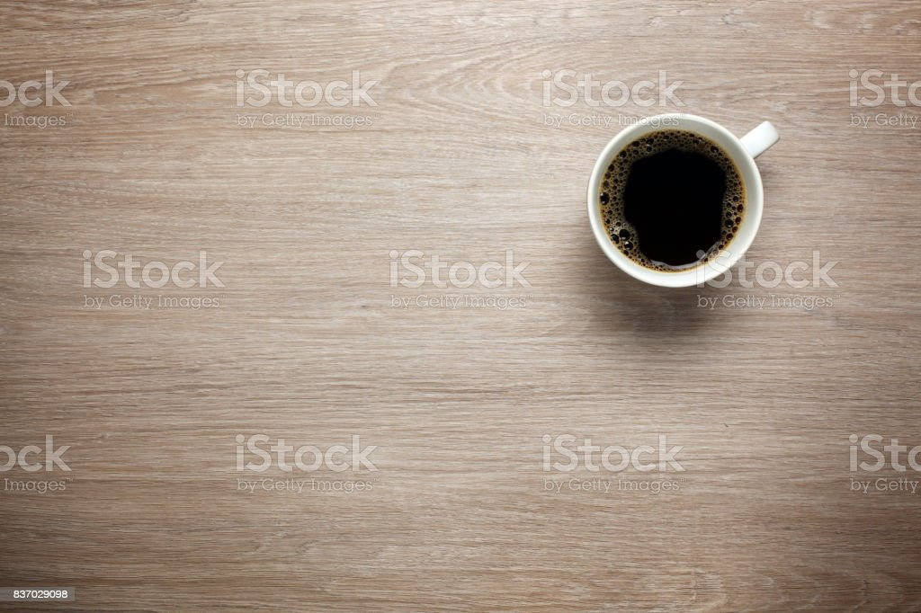Cup of coffee on desk stock photo