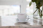 istock cup of coffee on marble table 857038058
