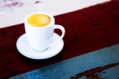 cup of coffee on old vintage wooden table