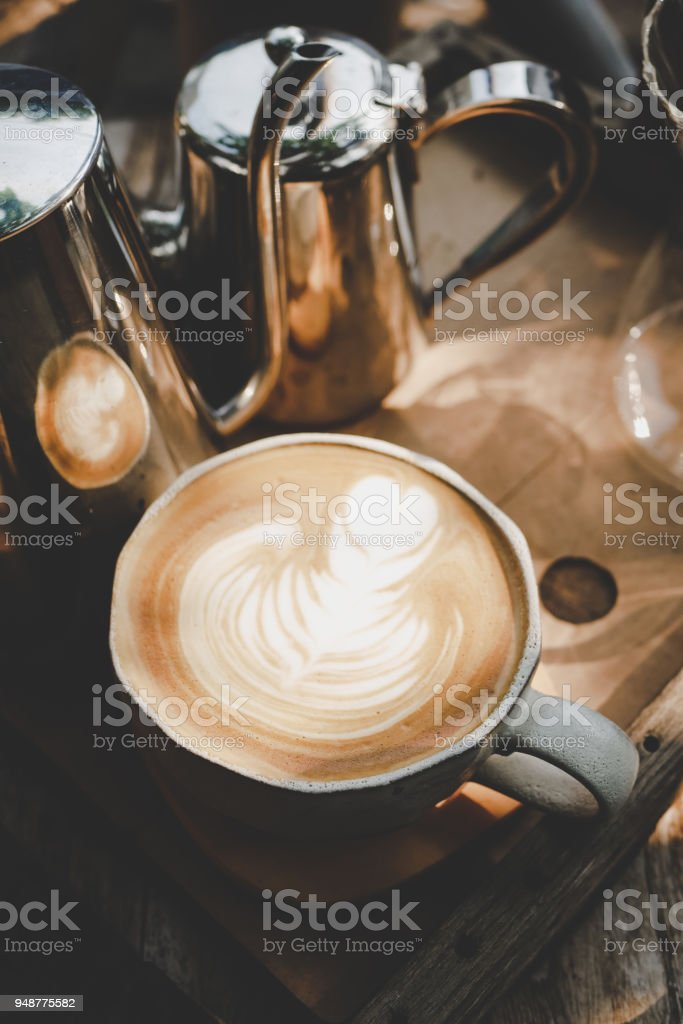 cup of coffee on old wood, vintage style. stock photo