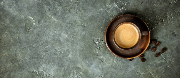 Cup of coffee on rustic background stock photo