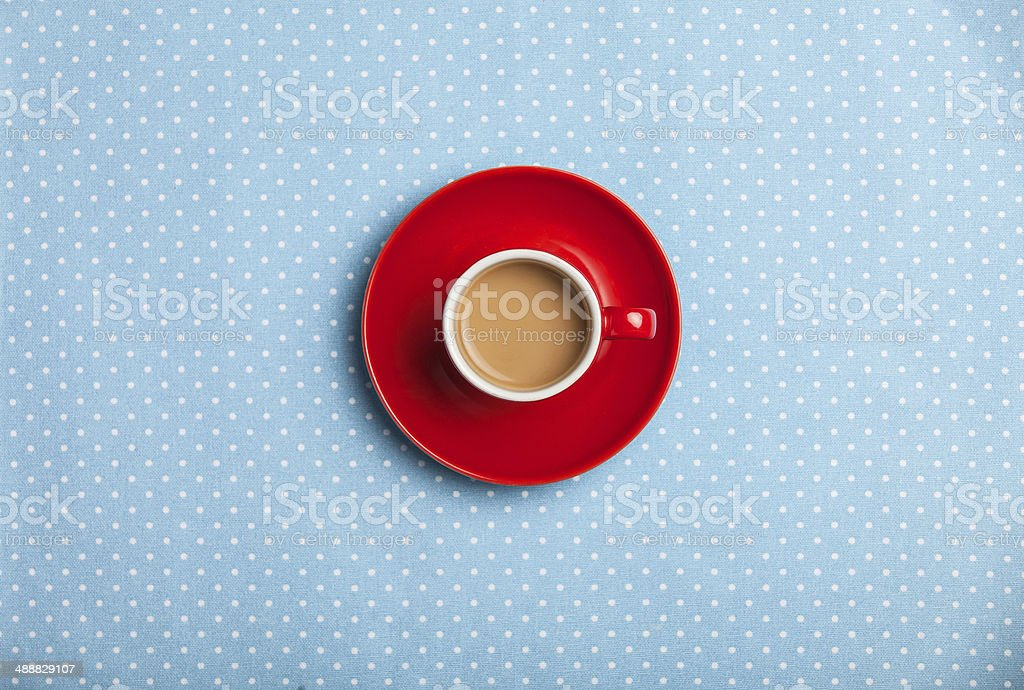 cup of coffee on speckled background. stock photo