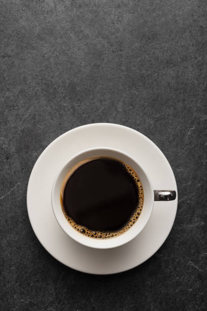 Cup of coffee on table Cup of coffee on gray table from above black coffee stock pictures, royalty-free photos & images
