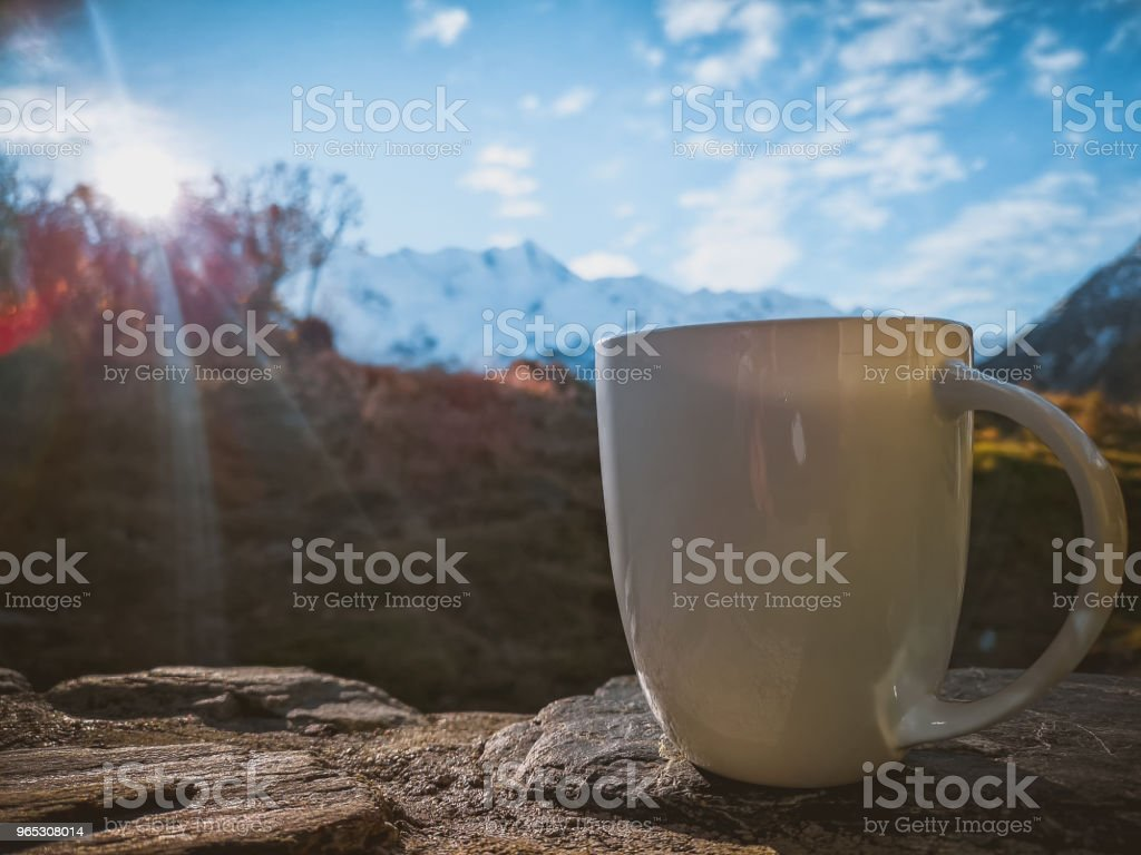 A cup of coffee on the background of snowy mountains royalty-free stock photo