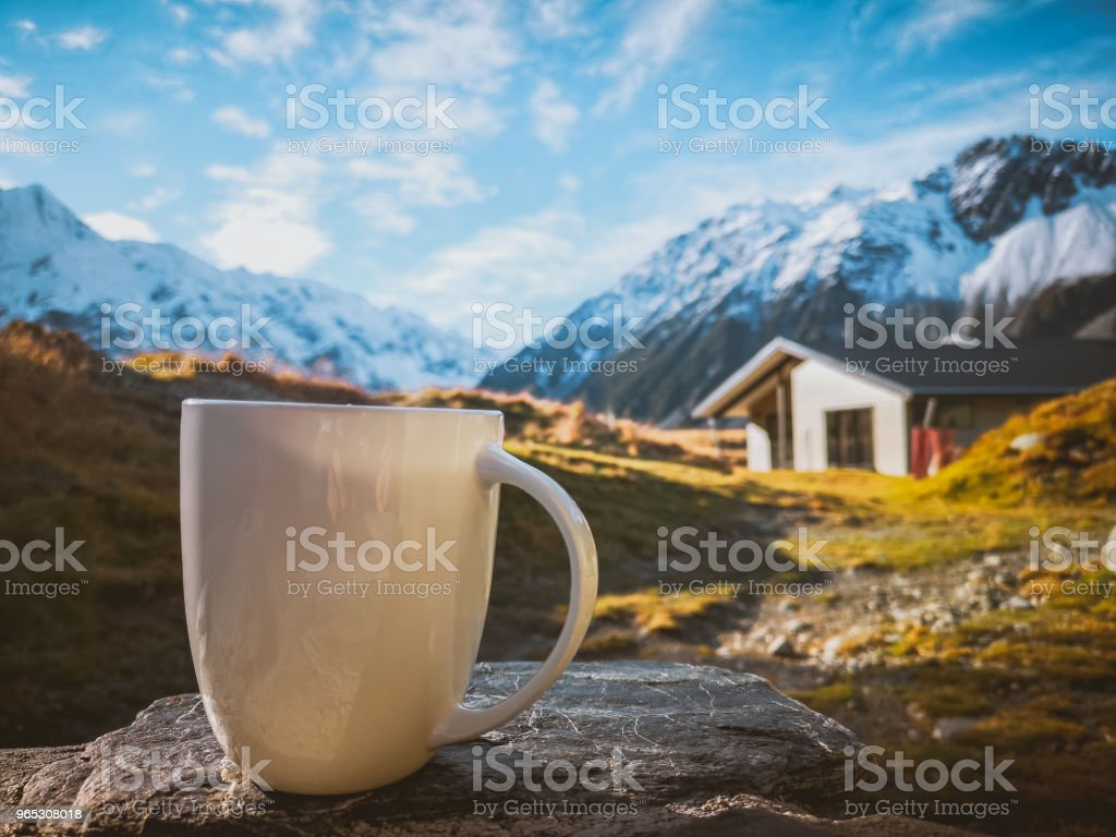 A cup of coffee on the background of snowy mountains zbiór zdjęć royalty-free