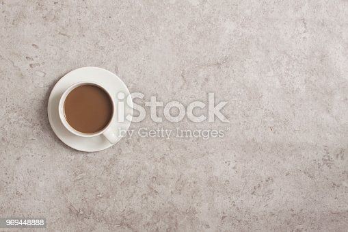 istock A cup of coffee on the stone table 969448888