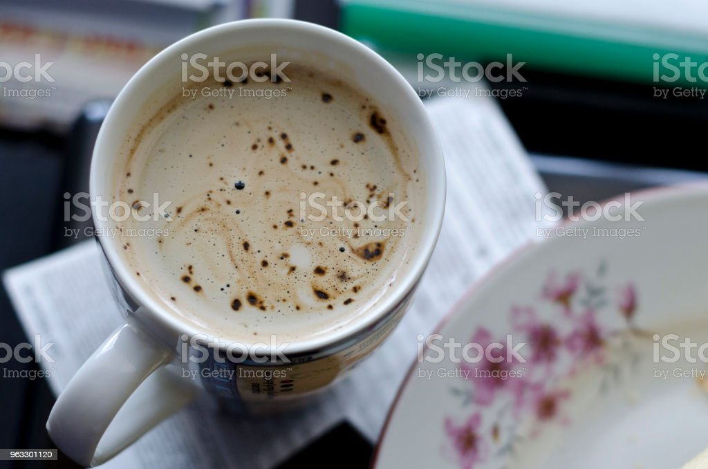 Cup of coffee on the table stock photo