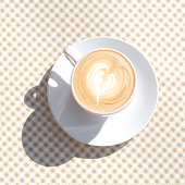 A cup of coffee on the table with a checkered tablecloth. Morning. Breakfast.