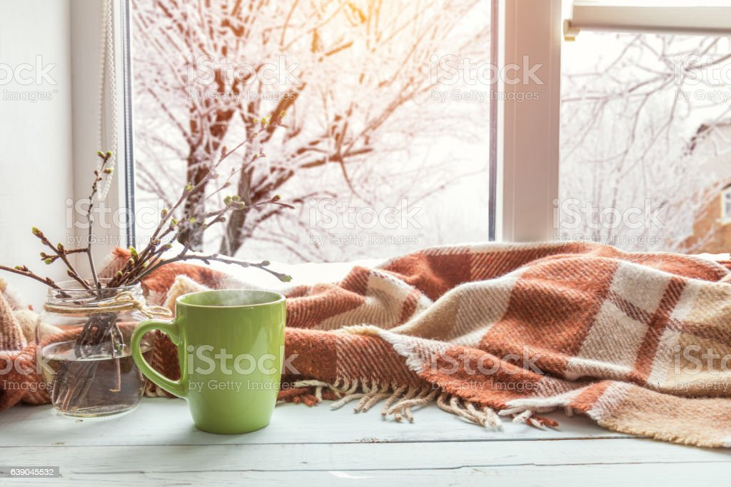 Cup of coffee on the window sill royalty-free stock photo