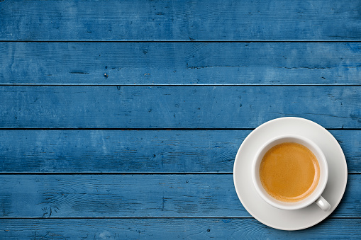 Cup of coffee on weathered blue table