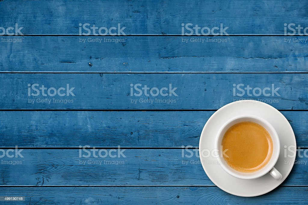 Cup of coffee on weathered blue table stock photo