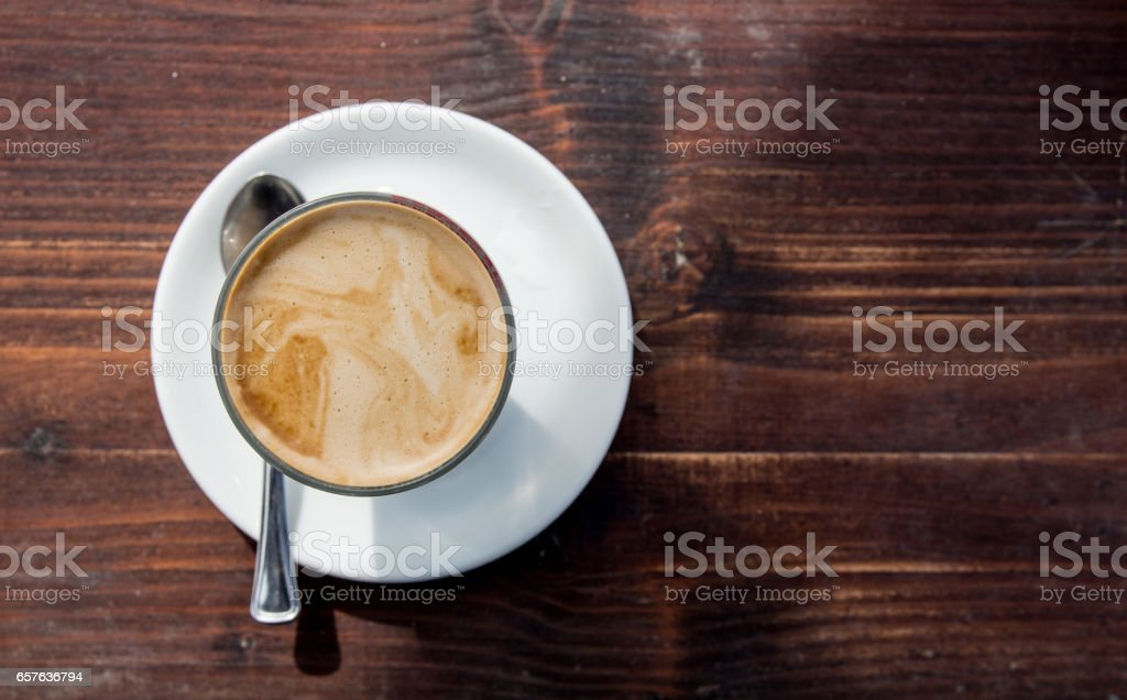 Cup of coffee on weathered brown wood table stock photo